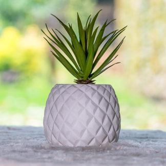 Artificial succulent in a pineapple shaped pot.