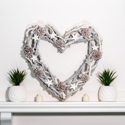 A gorgeous whitewashed heart shaped wreath, perfect for Christmas and weddings