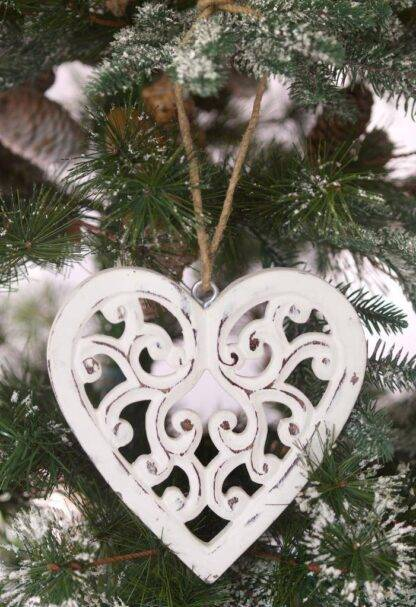 Filigree hanging heart, hand carved from mango wood and painted in a distressed vintage style white highlighted here on a Christmas tree