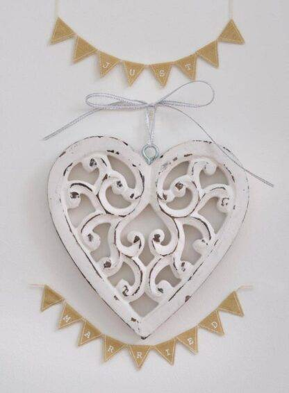 Filigree hanging heart, hand carved from mango wood and painted in a distressed white