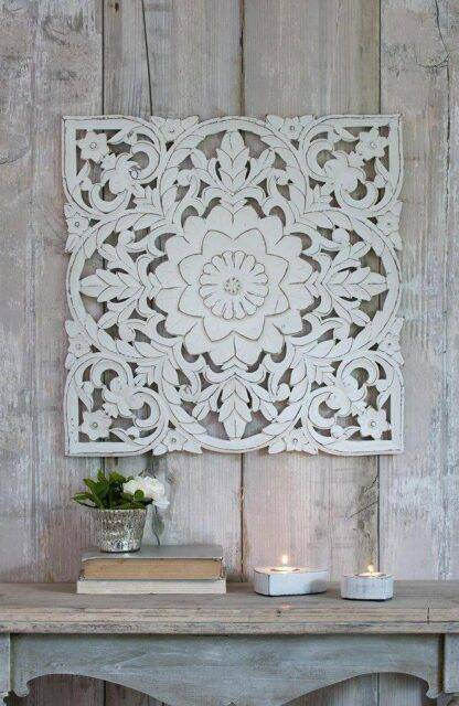 Ornate hand carved wall panel, beautifully painted in a distressed white