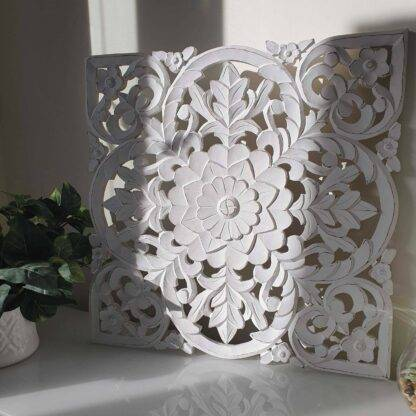 White hand carved wooden wall panel