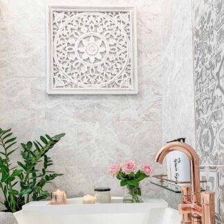 Carved white panel