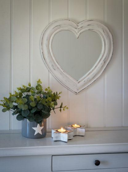 White heart shaped wall mirror